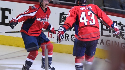 Washington Capitals right wing Tom Wilson (43) celebrates his overtime goal with center Jay Beagle (83) against the Toronto Maple Leafs during Game 1 of an NHL hockey Stanley Cup first-round playoff series in Washington, Thursday, April 13, 2017. The Capitals won 3-2. (AP Photo/Molly Riley)