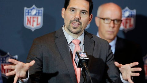 "FILE - In this Monday, March 24, 2014, file photo, NFL vice president of officiating Dean Blandino speaks during a news conference, while Atlanta Falcons President, CEO and NFL competition committee member Rich McKay, back right, listens, at the NFL football annual meeting in Orlando, Fla. Blandino, the NFL officiating director who has overseen rule changes that emphasized player safety, is leaving the league to spend more time with his family and explore other opportunities. ""Dean has done an outstanding job leading our officiating department,"" Troy Vincent, the league's executive vice president of football operations said Friday, April 14, 2017, after informing the 32 teams of Blandino's departure.(AP Photo/John Raoux, File)"