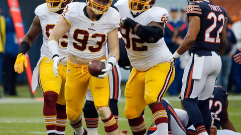 In this photo taken Dec. 13, 2015, Washington Redskins linebacker Trent Murphy (93) celebrates after tackling Chicago Bears quarterback Jay Cutler for a sack and recovering a fumble during the first half of an NFL football game in Chicago. Murphy has been suspended the first four games of next season for violating the NFL's performance-enhancing drug policy. (AP Photo/Charles Rex Arbogast, File)