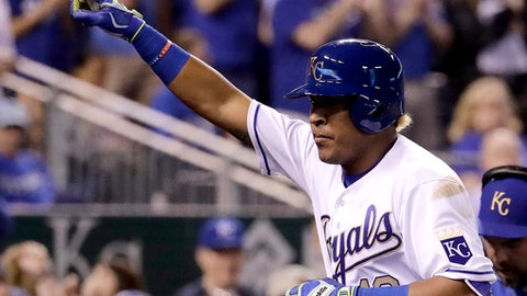 Kansas City Royals' Salvador Perez celebrates after hitting a solo home run during the sixth inning of a baseball game against the Los Angeles Angels, Friday, April 14, 2017, in Kansas City, Mo. (AP Photo/Charlie Riedel)