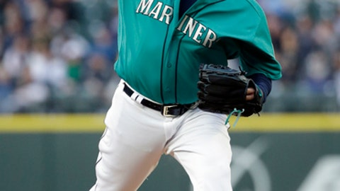Seattle Mariners starting pitcher Felix Hernandez throws against the Texas Rangers during the first inning of a baseball game Friday, April 14, 2017, in Seattle. (AP Photo/Elaine Thompson)