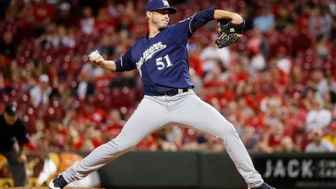 Milwaukee Brewers relief pitcher Oliver Drake throws during the ninth inning of the team's baseball game against the Cincinnati Reds, Friday, April 14, 2017, in Cincinnati. The Brewers won 10-4. (AP Photo/John Minchillo)