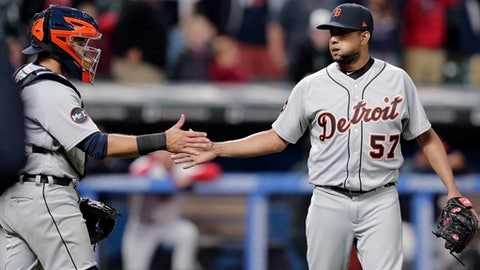 Detroit Tigers relief pitcher Francisco Rodriguez, right, and catcher Alex Avila celebrate after the Tigers defeated the Cleveland Indians 7-6 in a baseball game, Friday, April 14, 2017, in Cleveland. (AP Photo/Tony Dejak)