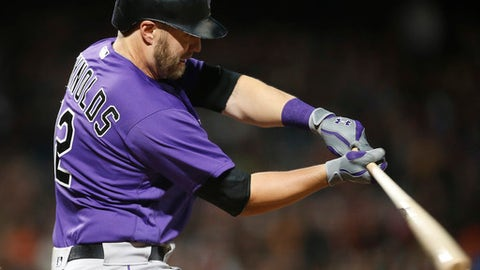 Colorado Rockies' Mark Reynolds hits a single against the San Francisco Giants during the fifth inning of a baseball game, Friday, April 14, 2017, in San Francisco. (AP Photo/Tony Avelar)
