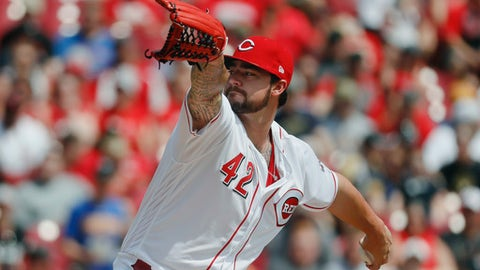 Cincinnati Reds starting pitcher Brandon Finnegan throws in the first inning of a baseball game against the Milwaukee Brewers, Saturday, April 15, 2017, in Cincinnati. (AP Photo/John Minchillo)