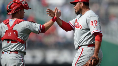 Philadelphia Phillies relief pitcher Joaquin Benoit, right, celebrates the team's win over the Washington Nationals with catcher Andrew Knapp, left, after a baseball game, Saturday, April 15, 2017, in Washington.  (AP Photo/Nick Wass)