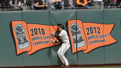 San Francisco Giants left fielder Jarrett Parker hits the outfield wall after catching a fly ball hit Colorado Rockies' DJ LeMahieu during the fourth inning of a baseball game in San Francisco, Saturday, April 15, 2017. Parker was injured on the play and left the game. (AP Photo/Jeff Chiu)