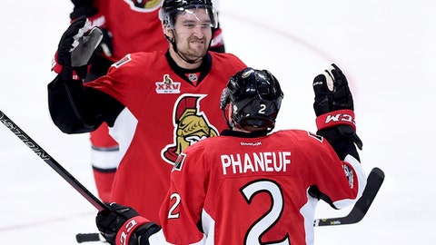 Ottawa Senators defenseman Dion Phaneuf (2) is congratulated by teammate Ottawa Senators right wing Mark Stone (61) on his goal during overtime of game two NHL Stanley Cup hockey playoff action against the Boston Bruins, in Ottawa, Saturday, April 15, 2017. (Sean Kilpatrick/The Canadian Press via AP)
