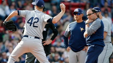 Tampa Bay Rays manager Kevin Cash, second from left, watches on the mound as Jake Odorizzi throws during the second inning of a baseball game against the Boston Red Sox in Boston, Saturday, April 15, 2017. (AP Photo/Michael Dwyer)