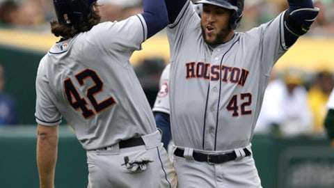 Houston Astros George Springer, right, celebrates after hitting a two-run home run off Oakland Athletics' Sean Doolittle in the eighth inning of a baseball game Saturday, April 15, 2017, in Oakland, Calif. (AP Photo/Ben Margot)