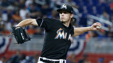 Miami Marlins' Adam Conley delivers a pitch during the first inning of a baseball game against the New York Mets, Saturday, April 15, 2017, in Miami. (AP Photo/Wilfredo Lee)