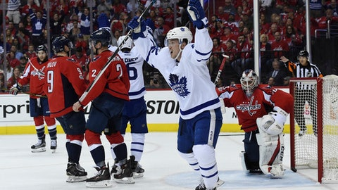 Toronto Maple Leafs center Tyler Bozak (42) celebrates a goal scored by left wing James van Riemsdyk (25) (not shown) as Washington Capitals goalie Braden Holtby (70) watches in front of defenseman Matt Niskanen (2) and defenseman Dmitry Orlov (9) during first period in Game 2 of an NHL Stanley Cup first round playoff series in Washington, Saturday, April 15, 2017. (AP Photo/Molly Riley)