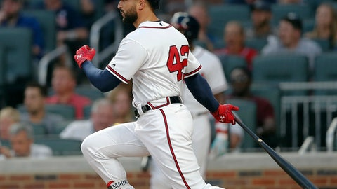 Atlanta Braves' Nick Markakis (22) drives in a run with a base hit in the third inning of a baseball game against the San Diego Padres, Saturday, April 15, 2017, in Atlanta. (AP Photo/John Bazemore)