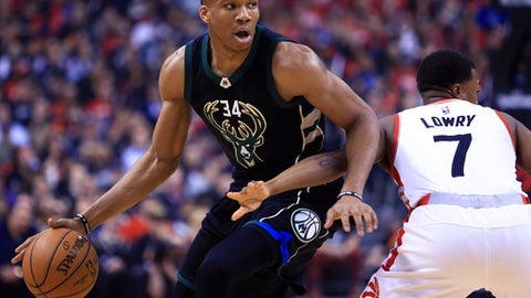 TORONTO, ON - APRIL 15:  Giannis Antetokounmpo #34 of the Milwaukee Bucks dribbles the ball as Kyle Lowry #7 of the Toronto Raptors defends in the first half of Game One of the Eastern Conference Quarterfinals during the 2017 NBA Playoffs at Air Canada Centre on April 15, 2017 in Toronto, Canada.  NOTE TO USER: User expressly acknowledges and agrees that, by downloading and or using this photograph, User is consenting to the terms and conditions of the Getty Images License Agreement.  (Photo by Vaughn Ridley/Getty Images)