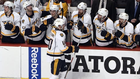 Nashville Predators center Colton Sissons (10) celebrates his goal against the Chicago Blackhawks with his teammates during the second period in Game 2 of a first-round NHL hockey playoff series, Saturday, April 15, 2017, in Chicago. (AP Photo/David Banks)