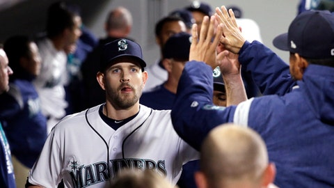 Seattle Mariners starting pitcher James Paxton is congratulated by teammates after coming out of the baseball game against the Texas Rangers in the eighth inning Saturday, April 15, 2017, in Seattle. (AP Photo/Elaine Thompson)