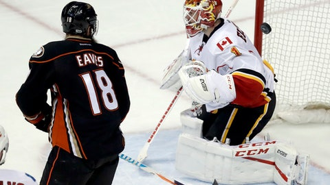 Anaheim Ducks right wing Patrick Eaves, left, watches Ryan Getzlaf's go-ahead goal get past Calgary Flames goalie Brian Elliott during the third period in Game 2 of a first-round NHL hockey Stanley Cup playoff series in Anaheim, Calif., Saturday, April 15, 2017.  The Ducks won 3-2. (AP Photo/Chris Carlson)