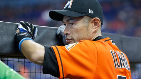 Miami Marlins' Ichiro Suzuki, of Japan, looks out from the dugout before the start of a baseball game against the New York Mets, Sunday, April 16, 2017, in Miami. (AP Photo/Wilfredo Lee)