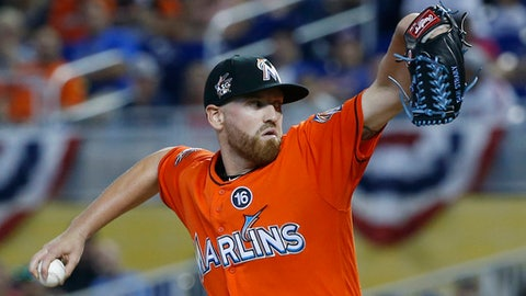 Miami Marlins' Dan Straily delivers a pitch during the first inning of a baseball game against the New York Mets, Sunday, April 16, 2017, in Miami. (AP Photo/Wilfredo Lee)