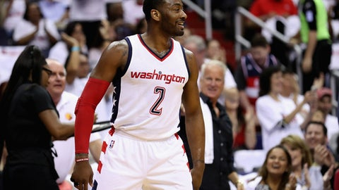 WASHINGTON, DC - APRIL 16: John Wall #2 of the Washington Wizards celebrates after scoring against the Atlanta Hawks in the first half in Game One of the Eastern Conference Quarterfinals during the 2017 NBA Playoffs at Verizon Center on April 16, 2017 in Washington, DC. NOTE TO USER: User expressly acknowledges and agrees that, by downloading and or using this photograph, User is consenting to the terms and conditions of the Getty Images License Agreement.  (Photo by Rob Carr/Getty Images)