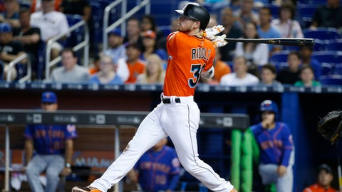 Miami Marlins' J.T. Riddle watches the ball as he hits a two-run home run during the ninth inning of a baseball game against the New York Mets, Sunday, April 16, 2017, in Miami. The Marlins defeated the Mets 4-2. (AP Photo/Wilfredo Lee)