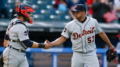 Detroit Tigers relief pitcher Francisco Rodriguez (57) and Alex Avila celebrate a 4-1 victory over the Cleveland Indians in a baseball game, Sunday, April 16, 2017, in Cleveland. (AP Photo/Ron Schwane)
