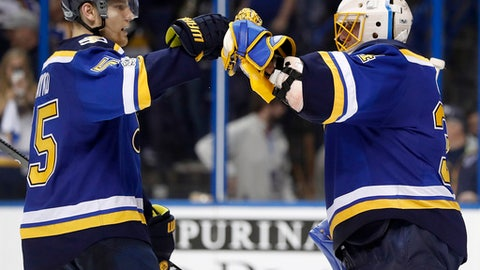 St. Louis Blues goalie Jake Allen, right, celebrates with Colton Parayko after the Blues' 3-1 victory over the Minnesota Wild in Game 3 of an NHL hockey first-round playoff series, Sunday, April 16, 2017, in St. Louis. The Blues won 3-1. (AP Photo/Jeff Roberson)