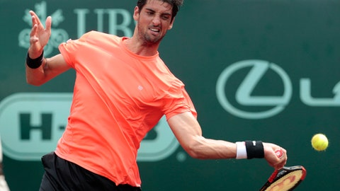 Thomaz Bellucci hits a forehand return against Steve Johnson during the championship singles match of the U.S. Men's Clay Court Championship tennis tournament at River Oaks Country Club on Sunday, April 16, 2017, in Houston. Johnson defeated Bellucci, of Brazil, 6-4, 4-6, 7-6 (5), to take the title. (Brett Coomer/Houston Chronicle via AP)