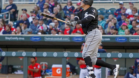 Chicago White Sox Avisail Garcia watches as his 2 run home run against the Minnesota Twins leaves the park in the tenth inning of a baseball game, Sunday, April 16, 2017, in Minneapolis. The White Sox won 3-1 in 10 innings. (AP Photo/Bruce Kluckhohn)
