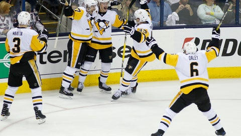 Pittsburgh Penguins' Jake Guentzel, center, celebrates his game-winning goal with teammates Olli Maatta, left to right, of Finland, Sidney Crosby, Conor Sheary, and Trevor Daley against the Columbus Blue Jackets during the first overtime period in Game 3 of a first-round NHL hockey playoff series, Sunday, April 16, 2017, in Columbus, Ohio. The Penguins defeated the Blue Jackets 5-4. (AP Photo/Jay LaPrete)