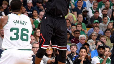 BOSTON, MA - APRIL 16:  Jimmy Butler #21 of the Chicago Bulls shoots the ball against the Boston Celtics during the Eastern Conference Quarter-finals of the 2017 NBA Playoffs on April 16, 2017 at TD Garden in Boston, MA. NOTE TO USER: User expressly acknowledges and agrees that, by downloading and or using this Photograph, user is consenting to the terms and conditions of the Getty Images License Agreement. Mandatory Copyright Notice: Copyright 2017 NBAE (Photo by Brian Babineau/NBAE via Getty Images)