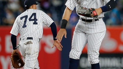 New York Yankees' Ronald Torreyes (74) and Aaron Judge celebrate after defeating the St. Louis Cardinals 9-3 in a baseball game Sunday, April 16, 2017 at Yankee Stadium in New York. (AP Photo/Rich Schultz)