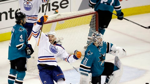 Edmonton Oilers' Zack Kassian, bottom center, celebrates after scoring against the San Jose Sharks during the third period in Game 3 of a first-round NHL hockey playoff series Sunday, April 16, 2017, in San Jose, Calif. (AP Photo/Marcio Jose Sanchez)