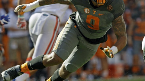 FILE - In this Sept. 24, 2016, file photo, Tennessee defensive end Derek Barnett (9) plays against Florida in an NCAA college football game, in Knoxville, Tenn. They began their college careers at the same time, played in the same conference and had similar production. Now they're both ready to launch their pro careers. Yet while Myles Garrett is considered the likely No. 1 overall pick in this month's NFL Draft, Derek Barnett likely won't get taken until later in the first round.  (AP Photo/Wade Payne, File)