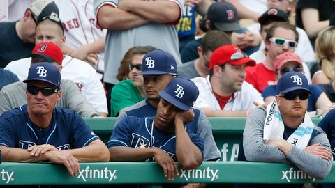 The Tampa Bay Rays watch from the dug out during the ninth inning of a baseball game against the Boston Red Sox Monday, April 17, 2017, in Boston. The Red Sox won 4-3. (AP Photo/Michael Dwyer)