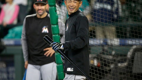 Miami Marlins' Ichiro Suzuki smiles as he steps out of the cage during batting practice before a baseball game against his former team, the Seattle Mariners, Monday, April 17, 2017, in Seattle. (AP Photo/Ted S. Warren)