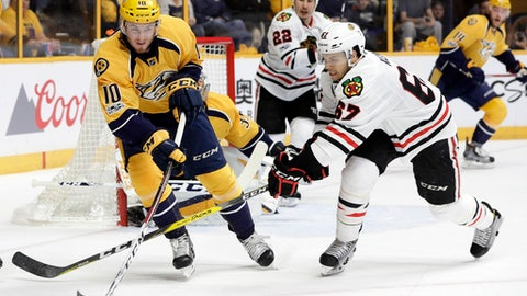 Nashville Predators center Colton Sissons (10) passes the puck away from Chicago Blackhawks center Tanner Kero (67) during the first period in Game 3 of a first-round NHL hockey playoff series, Monday, April 17, 2017, in Nashville, Tenn. (AP Photo/Mark Humphrey)