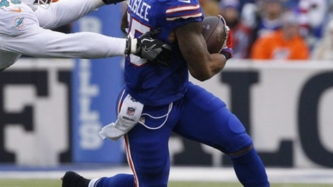 Buffalo Bills' Mike Gillislee (35) runs away from Miami Dolphins' Neville Hewitt (46) during the second half of an NFL football game Saturday, Dec. 24, 2016, in Orchard Park, N.Y. (AP Photo/Bill Wippert)