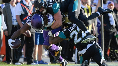 FILE - In this Dec. 11, 2016, file photo, Minnesota Vikings wide receiver Cordarrelle Patterson (84) is stopped by Jacksonville Jaguars middle linebacker Paul Posluszny (51) and cornerback Aaron Colvin (22) after a reception during the second half of an NFL football game, in Jacksonville, Fla. Posluszny is switching positions for the first time in his NFL career, and he doesn't seem totally comfortable with the decision. Posluszny said Tuesday, April 18, 2017, that new coach Doug Marrone is moving him from middle linebacker _ the spot he's played since peewee football _ to strong-side linebacker. (AP Photo/Phelan M. Ebenhack, File)
