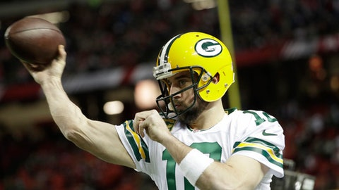 FILE - In this Sunday, Jan. 22, 2017, file photo, Green Bay Packers quarterback Aaron Rodgers warms up before the NFL football NFC championship game against the Atlanta Falcons in Atlanta. Following the Packers' drubbing at the hands of the Atlanta Falcons in last season's NFC Championship, Rodgers said the team needed to reload. Green Bay's revamped roster convened for the first time Tuesday, April 18, for the start of the offseason program. (AP Photo/David Goldman, File)