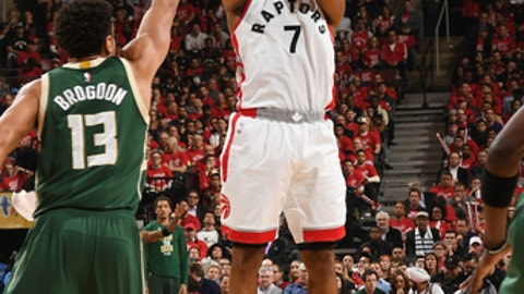 TORONTO, CANADA - APRIL 18:  Kyle Lowry #7 of the Toronto Raptors shoots the ball against the Milwaukee Bucks during Game Two of the Eastern Conference Quarterfinals of the 2017 NBA Playoffs on April 18, 2017 at the Air Canada Centre in Toronto, Ontario, Canada. NOTE TO USER: User expressly acknowledges and agrees that, by downloading and/or using this photograph, user is consenting to the terms and conditions of the Getty Images License Agreement.  Mandatory Copyright Notice: Copyright 2017 NBAE (Photo by Ron Turenne/NBAE via Getty Images)