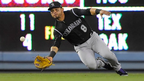 Colorado Rockies left fielder Gerardo Parra can't get to a ball hit for a single by Los Angeles Dodgers' Corey Seager during the ninth inning of a baseball game, Tuesday, April 18, 2017, in Los Angeles. (AP Photo/Mark J. Terrill)