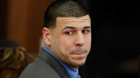 FILE - In this Friday, April 14, 2017, file photo, Former New England Patriots tight end Aaron Hernandez turns to look in the direction of the jury as he reacts to his double murder acquittal at Suffolk Superior Court in Boston. Hernandez hung himself and was pronounced dead at a Massachusetts hospital early Wednesday, April 19, 2017, according to officials. (AP Photo/Stephan Savoia, Pool, File)
