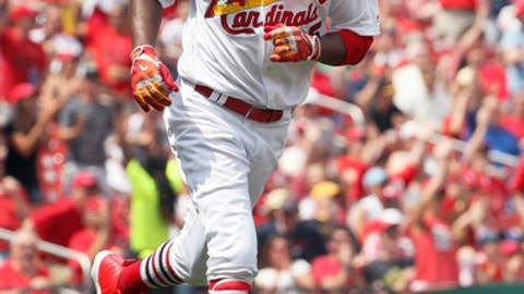 St. Louis Cardinals' Dexter Fowler watches his solo home run during the fifth inning of a baseball game Pittsburgh Pirates Wednesday, April 19, 2017, in St. Louis. The home run was Fowler's second of the game. (AP Photo/Jeff Roberson)