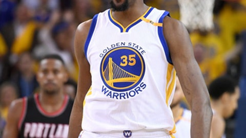 OAKLAND, CA - APRIL 16:  Kevin Durant #35 of the Golden State Warriors reacts after they make a defensive stop against the Portland Trail Blazers in the fourth quarter during Game One of the first round of the 2017 NBA Playoffs at ORACLE Arena on April 16, 2017 in Oakland, California. NOTE TO USER: User expressly acknowledges and agrees that, by downloading and or using this photograph, User is consenting to the terms and conditions of the Getty Images License Agreement.  (Photo by Thearon W. Henderson/Getty Images)