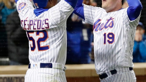 New York Mets' Yoenis Cespedes (52) and Jay Bruce (19) celebrate after Bruce hit a two run home run during the eighth inning of a baseball game against the Philadelphia Phillies, Wednesday, April 19, 2017, in New York. The Mets won 5-4. (AP Photo/Frank Franklin II)