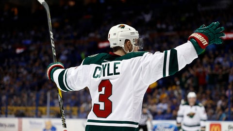 Minnesota Wild's Charlie Coyle celebrates after scoring during the first period in Game 4 of the team's NHL hockey first-round playoff series against the St. Louis Blues on Wednesday, April 19, 2017, in St. Louis. (AP Photo/Jeff Roberson)
