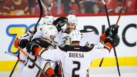 Anaheim Ducks' Ryan Getzlaf, second from right, celebrates a goal by teammate Patrick Eaves, not seen, with other teammates during the first period against the Calgary Flames in Game 4 in a first-round NHL hockey Stanley Cup playoff series Wednesday, April 19, 2017, in Calgary, Alberta. (Jeff McIntosh/The Canadian Press via AP)