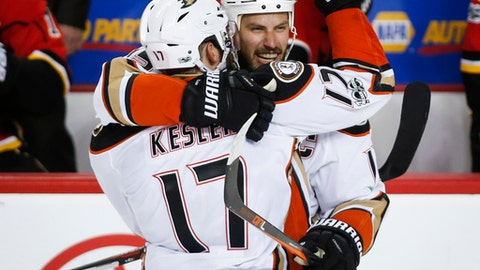 Anaheim Ducks' Ryan Getzlaf, right, celebrates his empty-net goal with teammate Ryan Kesler during the third period of Game 4 in a first-round NHL hockey Stanley Cup playoff series against the Calgary Flames on Wednesday, April 19, 2017, in Calgary, Alberta. (Jeff McIntosh/The Canadian Press via AP)