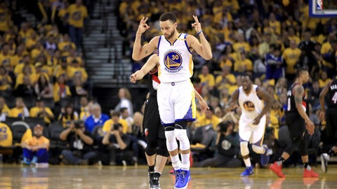 OAKLAND, CA - APRIL 19:  Stephen Curry #30 of the Golden State Warriors reacts after making a three-point basket during their game against the Portland Trail Blazers in Game Two of the Western Conference Quarterfinals during the 2017 NBA Playoffs at ORACLE Arena on April 19, 2017 in Oakland, California. NOTE TO USER: User expressly acknowledges and agrees that, by downloading and or using this photograph, User is consenting to the terms and conditions of the Getty Images License Agreement.  (Photo by Ezra Shaw/Getty Images)